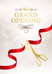 Grand opening banner with cut red ribbon and gold scissors.