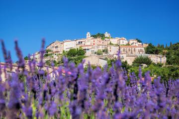 Simiane la Rotonde village with lavender field in Provence, France