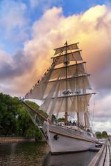 Sailing ship moored at the quay at sunset