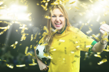 Female Athlete celebrating on yellow and green uniform