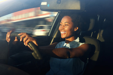 Young african american woman driving a car Wall mural