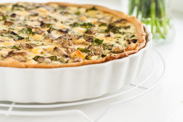 tart with mushrooms, a spinach and cheese