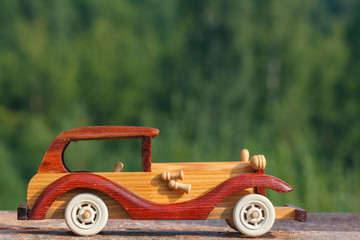 Wooden toy car on a rustic surface