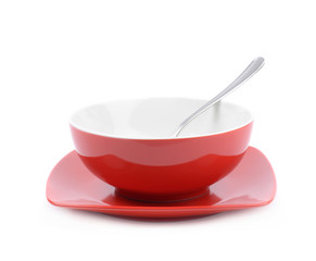 Red and white ceramic bowl isolated