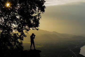 Photographer on cliff