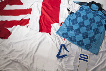 Colorful soccer jerseys laid out on the floor