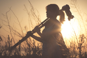 Vintage portrait of a young girl photographer working in the field of professional photographic equipment
