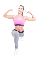 Fit girl posing in lunge position showing biceps