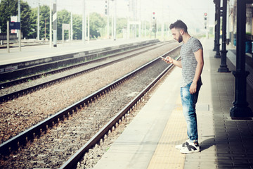 Young Man at the train station.