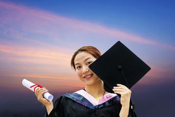 Beautiful female graduates wearing a graduation gown
