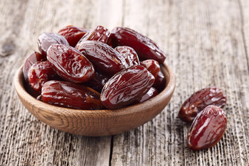Dates fruit on a wooden background