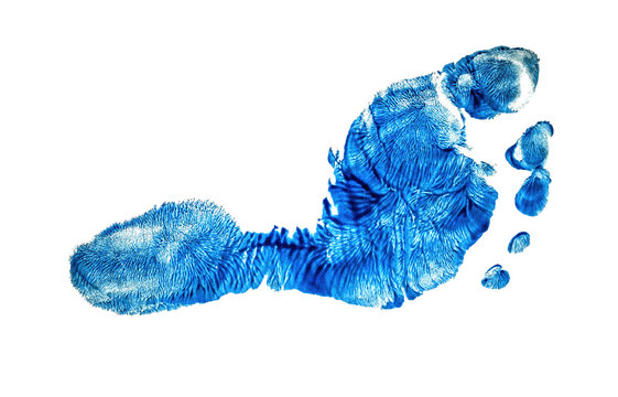 Real imprint of child foot in blue color isolated on white background
