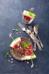 Watermelon slice popsicles with chocolate, nuts and mint