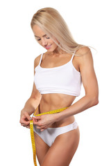 tape measure around woman waist