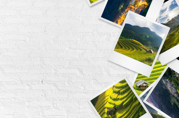 Mu Cang Chai photo papers on white wall.