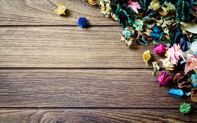 aromatherapy potpourri mix of dried aromatic flowers on wooden b