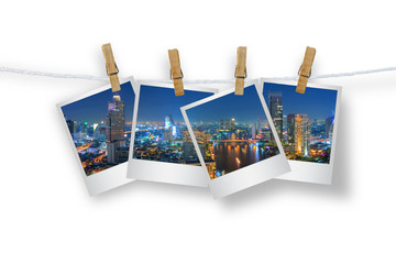 Clothespin hanging with photo cityscape skyscrapers of Bangkok,i