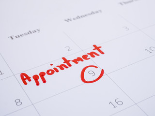 Woman hand write appointment on calendar 4