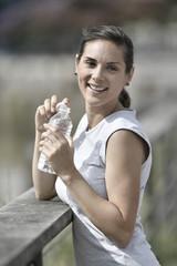 Jogger woman relaxing after exercising