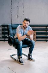 Bearded stylish man on leather chair