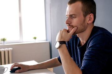 Bearded adult using laptop in office