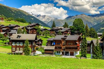 Spectacular alpine village and high mountains,Bernese Oberland,Switzerland,Europe Wall mural