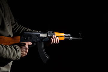 Kalashnikov assault rifle close-up in the dark