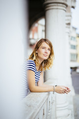 Italy, portrait of young woman looking at distance