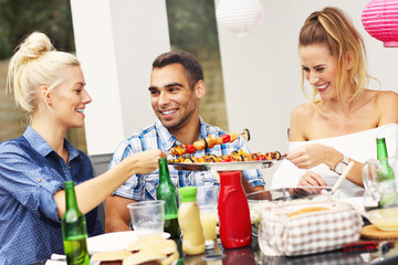 Group of friends having barbecue party