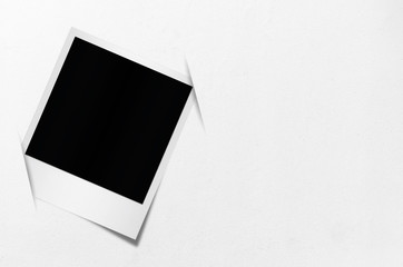 Blank photo papers on wall.
