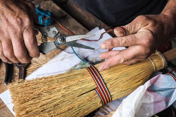 Traditional broom maker in the saxon village of Altana, Sibiu, R