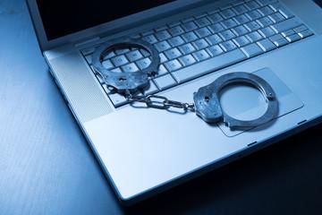 Handcuff on laptop