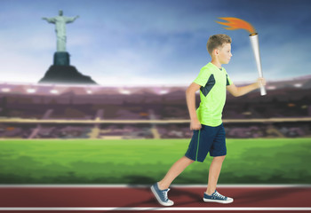 Young athlete boy with sport torch bearer running