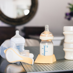 Baby bottle with milk and manual breast pump