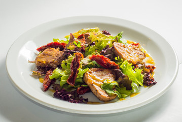 dish of salad with vegetables and meat
