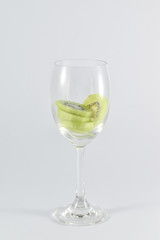 kiwi fruit in a glass wine isolated on white background.