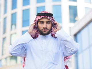 Outdoors portrait of a handsome arabian man