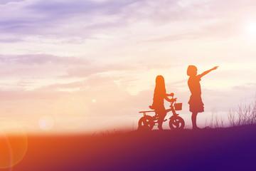 two little girls bike silhouette