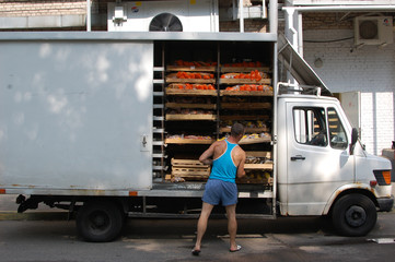 Minsk, Belarus - august 1, 2016, Uploading products from bakery bread van