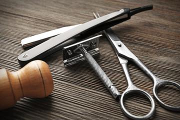 Vintage tools of barber shop on wooden background