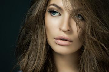 Woman with beauty long brown hair - posing at studio