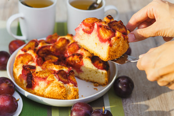 Plum cake and two cups of tea