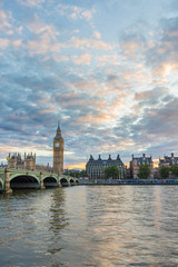 Big Ben, Westminster bridge and cloudy colorful sky. London, Uni