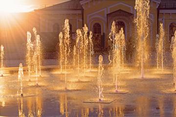 Fountain under sunbeams