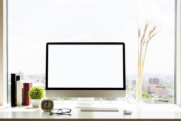 Designer workplace with blank monitor