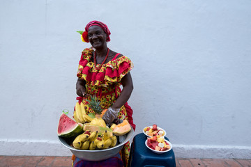 Woman sells fruits in the streets of Cartagena Colombia