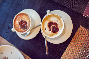 Coffee with hearts in a cafe