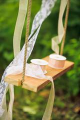 Lace tape reels on a swing