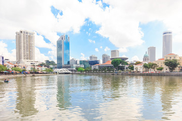 SINGAPORE - MAY 16, 2016. View of Singapore river with downtown buildings in the background.