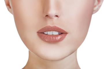 Beautiful young woman lips close-up.